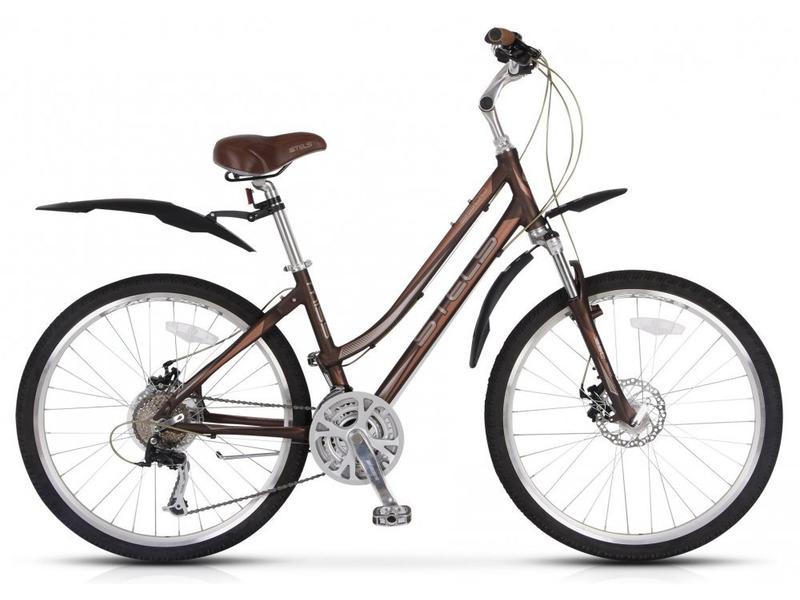 Miss 9500 MD (2015)Женский прогулочный велосипед с оборудованием предпрофессионального класса Shimano, 24 скорости. Технические особенности: прочная алюминиевая рама, амортизационная вилка RST Neon, двойные обода Weinmann, дисковые тормоза Tektro Novela. Подходит для прогулочной езды по различным дорогам. Диаметр колес - 26 дюймов. Вес - 15,2 кг.<br><br>Рама: алюминий<br>Вилка: RST Neon, ход 75мм<br>Манетки: Shimano Alivio, SL-M360<br>Тормоза: Tektro Novela, механический дисковый, ротор 160мм<br>Передний переключатель: Shimano Tourney, FD-TX51<br>Задний переключатель: Shimano Alivio, RD-T4000<br>Передняя втулка: Joy Tech, алюминий<br>Задняя втулка: Joy Tech, алюминий<br>Система: SR Suntour, сталь, 28/38/48T<br>Каретка: VP, картридж<br>Кассета: Shimano Altus, CS-HG41<br>Педали: VP, алюминий<br>Рулевая колонка: VP, сталь<br>Седло: Velo<br>Обода: Weinmann, алюминий, двойные<br>Покрышки: Chao Yang, 26<br>Цвета выпускаемые: коричневый/светло-коричневый<br>Размеры выпускаемые: 15.7