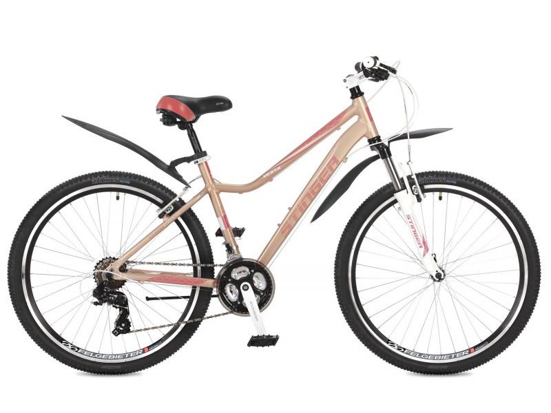 Vesta 26 (2017)Женский спортивный велосипед с оборудованием начального класса Shimano, 21 скорость. Технические особенности: легкая алюминиевая рама, амортизационная вилка Stinger, двойные обода Felgebeiter HAC-2, надежные ободные тормоза STG V-Brake. Подходит для прогулочного катания по различным дорогам и пересеченной местности. Диаметр колес - 26 дюймов.<br><br>Рама: Алюминий<br>Вилка: Stinger, ход 80 мм<br>Манетки: Microshift TS-38; куркового типа; 3x7ск.<br>Тормоза: STG V-Brake; алюминий<br>Передний переключатель: Shimano Tourney FD-TY500<br>Задний переключатель: Shimano Tourney<br>Передняя втулка: DC HB-01; сталь; эксцентрики<br>Задняя втулка: DC HB-01; сталь; эксцентрики<br>Система: Stinger FCM; 170мм; 42/34/24t<br>Каретка: STG BBP-08A; картридж<br>Кассета: Shimano Tourney MF-TZ21; 7ск. 14-28<br>Цепь: Taya TS-80<br>Педали: FEIMIN FP807; пластик<br>Рулевая колонка: Feimin FP-H835B<br>Вынос: STG 078; алюминий<br>Руль: Стальной райзер; 31.8мм x 660мм<br>Подседельный штырь: Stinger алюминий; 27.2мм<br>Седло: Stinger<br>Обода: Felgebeiter HAC-2; двойные<br>Покрышки: Z-Axis 786 26x2.0?<br>Цвета выпускаемые: розовый<br>Размеры выпускаемые: 15, 17?