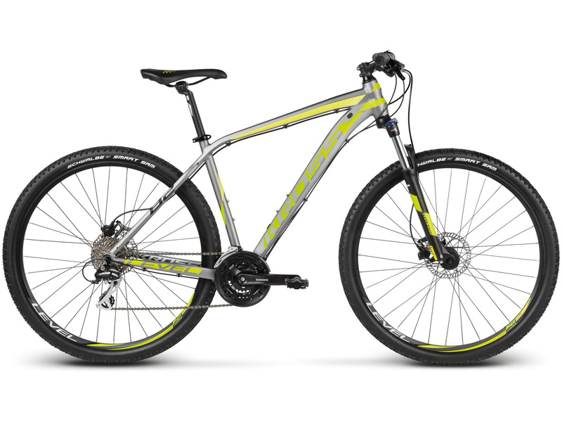 Level B2 (2017)Велосипеды Горные<br>Хардтейл для езды в стиле кросс-кантри с оборудованием любительского класса Shimano, 24 скорости. Технические особенности: алюминиевая рама Aluminium Lite, амортизационная вилка Suntour XCT HLO, двойные обода Kross Disc, дисковые гидравлические тормоза Tektro HDC-300. Подходит для активной езды по различным дорогам и пересеченной местности. Диаметр колес - 29 дюймов. Вес - 14,4 кг.<br><br>Рама: Aluminium Lite<br>Вилка: Suntour XCT HLO (travel 100mm, remote lockout)<br>Манетки: Shimano Altus SL-M310 3x8<br>Тормоза: Tektro HDC-300 (disc, hydraulic, rotor S/M/L - 160mm, XL - 180mm)<br>Передний переключатель: Shimano FD-TY700<br>Задний переключатель: Shimano Acera RD-M360 SGS<br>Передняя втулка: Joy Tech D041DSE<br>Задняя втулка: Joy Tech D142DSE<br>Система: Shimano FC-TY701 42/34/24T<br>Каретка: FP-B902<br>Кассета: Shimano<br>Цепь: Shimano CN-HG40<br>Педали: FP-917N<br>Рулевая колонка: FP-H816 1-1/8?<br>Вынос: Kross Sport Components (alloy, S - 80mm, M - 90mm, L - 100mm, XL - 110mm, rise 7 deg)<br>Руль: Kross Sport Components (alloy, 720mm, 31.8mm)<br>Подседельный штырь: Kross Sport Components (alloy, S/M - 350mm, L/XL - 400mm, 27,2mm)<br>Седло: Kross VL-1354<br>Обода: Kross Disc (alloy, double wall)<br>Покрышки: Schwalbe Smart Sam 29x2.1?<br>Цвета выпускаемые: серый/зеленый, черный/красный<br>Размеры выпускаемые: 17, 19, 21, 23?